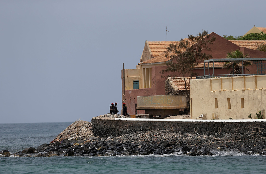 Description of . Senegalese soldiers stand guard near the slave house on Goree Island, ahead of a visit by U.S. President Barack Obama, in Dakar, Senegal, Thursday, June 27, 2013. Obama is calling his visit to a Senegalese island from which Africans were said to have been shipped across the Atlantic Ocean into slavery, a 'very powerful moment.' President Obama was in Dakar Thursday as part of a weeklong trip to Africa, a three-country visit aimed at overcoming disappointment on the continent over the first black U.S. president's lack of personal engagement during his first term.(AP Photo/Rebecca Blackwell)