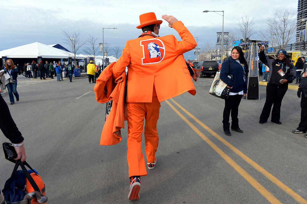 Description of . Tom Harrington of Denver, Colorado sports his Broncos tuxedo on his way into the stadium prior to the game.  Harrington predicts a 34 to 24 Broncos victory.  The Denver Broncos vs the Seattle Seahawks in Super Bowl XLVIII at MetLife Stadium in East Rutherford, New Jersey Sunday, February 2, 2014. (Photo by Craig Walker/The Denver Post)