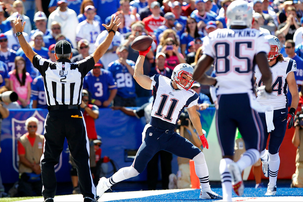 Description of . New England Patriots' Julian Edelman (11) celebrates after catching a touchdown pass from quarterback Tom Brady during the first half of an NFL football game against the Buffalo Bills, Sunday, Sept. 8, 2013, in Orchard Park. (AP Photo/Bill Wippert)