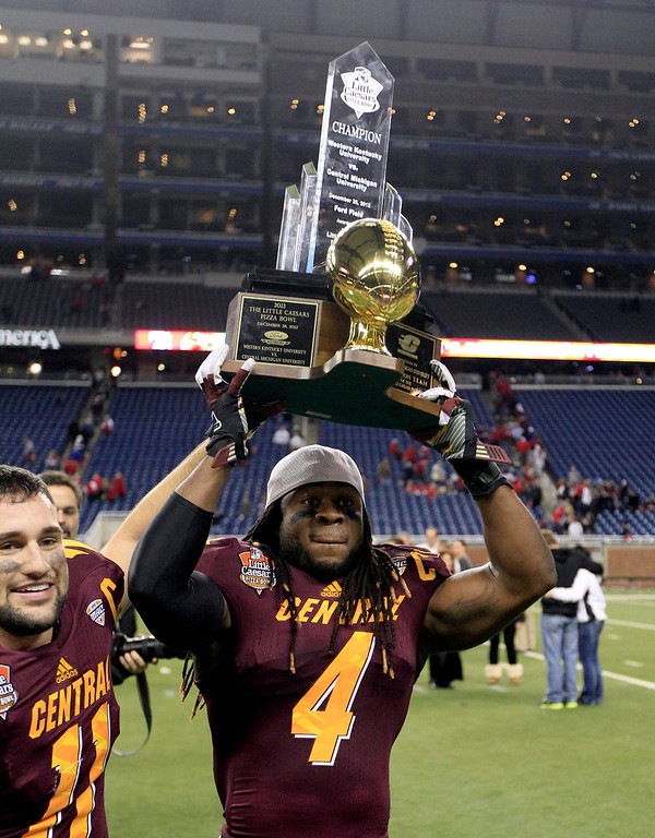 Description of . Central Michigan defensive back Jahleel Addae (4) holds the trophy after their 24-21 win over Western Kentucky in the Little Caesars Pizza Bowl NCAA college football game at Ford Field in Detroit, Wednesday, Dec. 26, 2012. (AP Photo/Carlos Osorio)
