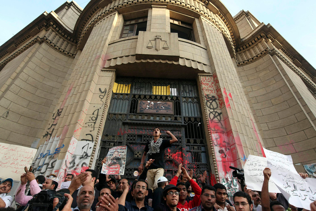 Description of . Anti-Mursi demonstrators and members of the 6th of April activist movement shout slogans in front of the High Court during a rally in Cairo April 6, 2013. The movement calls for a 'Day of Rage' to protest against the arrest of activists and the stifling of free expression. The movement was one of the key players in the uprising that toppled former President Hosni Mubarak.  REUTERS/Mohamed Abd El Ghany