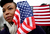 Quinnette Ellis from Tampa Bay, Florida stands with flags near the U.S. Capitol building on the National Mall after the Inauguration ceremony on January 21, 2013 in Washington, DC. U.S. President Barack Obama was ceremonially sworn in for his second term today.  (Photo by Mario Tama/Getty Images)