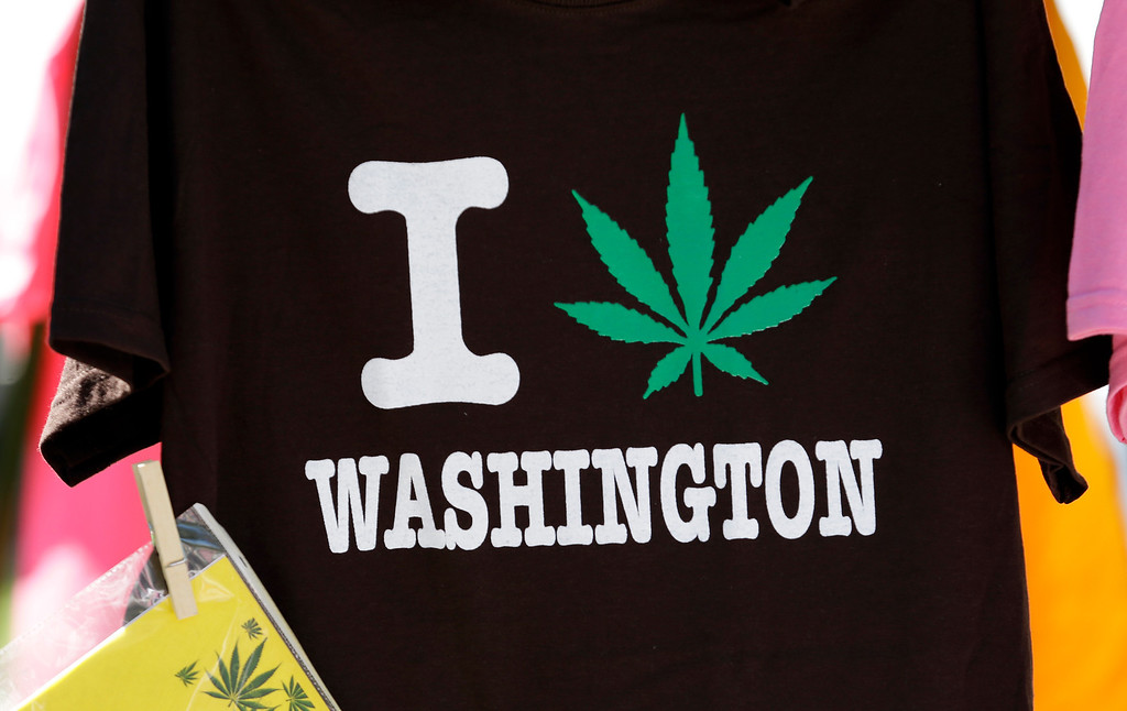 . A tee shirt is displayed at the first day of Hempfest, Friday, Aug. 16, 2013, in Seattle. Thousands packed the Seattle waterfront park for the opening of a three-day marijuana festival � an event that is part party, part protest and part victory celebration after the legalization of pot in Washington and Colorado last fall. Hempfest was expected to draw as many as 85,000 people per day. (AP Photo/Elaine Thompson)