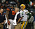 Aaron Rodgers #12 of the Green Bay Packers talks with Julius Peppers #90 of the Chicago Bears after Peppers was flagged for roughing Rodgers at Soldier Field on December 16, 2012 in Chicago, Illinois. The Packers defeated the Bears 21-13.  (Photo by Jonathan Daniel/Getty Images)