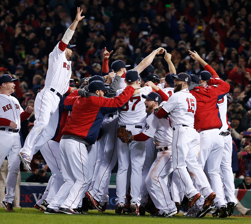 Description of . Boston Red Sox players celebrate after defeating the St. Louis Cardinals in Game 6 of baseball's World Series Wednesday, Oct. 30, 2013, in Boston. The Red Sox won 6-1 to win the series. (AP Photo/Elise Amendola)