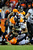 Denver Broncos defensive end Derek Wolfe (95) tackles Baltimore Ravens running back Ray Rice (27) in overtime. The Denver Broncos vs Baltimore Ravens AFC Divisional playoff game at Sports Authority Field Saturday January 12, 2013. (Photo by AAron  Ontiveroz,/The Denver Post)