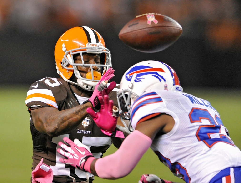 Description of . Buffalo Bills free safety Aaron Williams, right, breaks up a pass for Cleveland Browns wide receiver Davone Bess in the first quarter of an NFL football game Thursday, Oct. 3, 2013, in Cleveland. Williams was called for unnecessary roughness for a helmet-to-helmet hit. (AP Photo/David Richard)