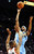 Denver Nuggets small forward Corey Brewer (13) shoots the ball over Portland Trail Blazers point guard Damian Lillard (0) during the first quarter of their NBA basketball game in Portland, Oregon, February 27, 2013.  REUTERS/Steve Dykes