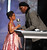 Quvenzhane Wallis, left, accepts the award for outstanding actress in a motion picture on behalf of Viola Davis for 