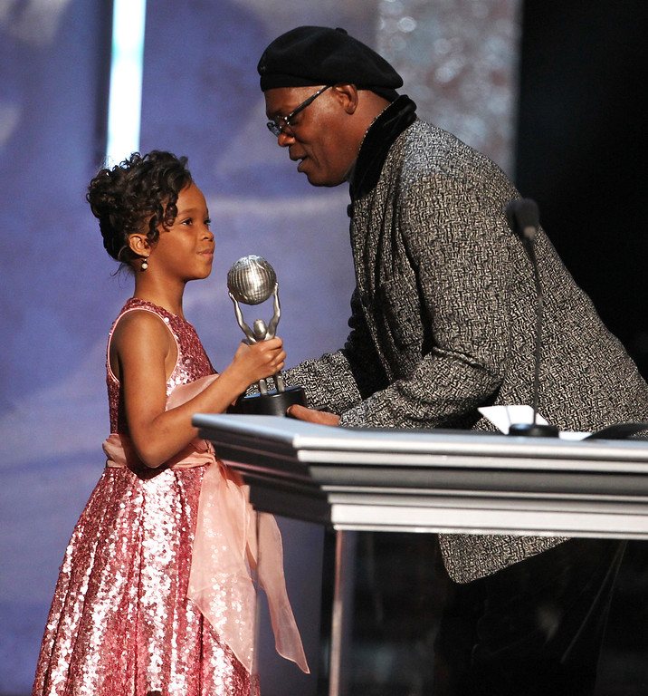 "Description of . Quvenzhane Wallis, left, accepts the award for outstanding actress in a motion picture on behalf of Viola Davis for ""Won\'t Back Down\"" from Samuel L. Jackson, at the 44th Annual NAACP Image Awards at the Shrine Auditorium in Los Angeles on Friday, Feb. 1, 2013. (Photo by Matt Sayles/Invision/AP)"