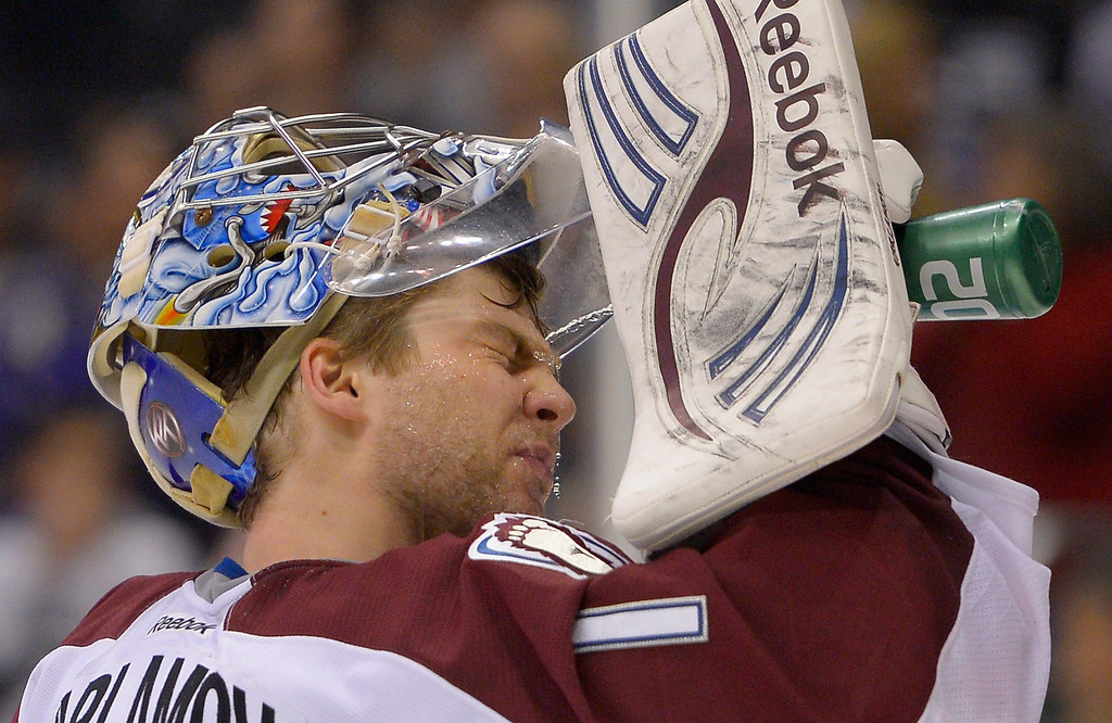 Description of . Colorado Avalanche goalie Semyon Varlamov, of Russia, washes his face after Los Angeles Kings center Trevor Lewis scored on him during the second period of their NHL hockey game, Saturday, Feb. 23, 2013, in Los Angeles. (AP Photo/Mark J. Terrill)