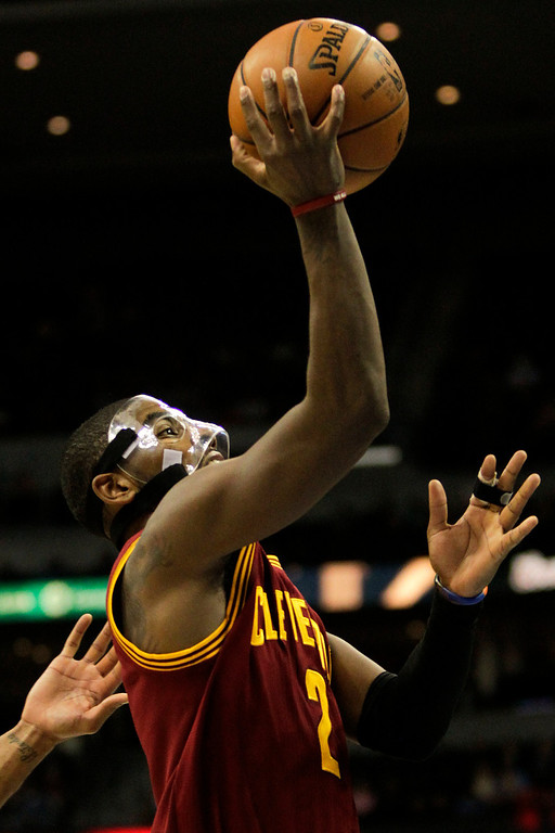 Description of . Cleveland Cavaliers' Kyrie Irving (2) heads to the basket during the fourth quarter of an NBA basketball game against the Denver Nuggets Friday, Jan. 11, 2013, in Denver. The Nuggets won 98-91 (AP Photo/Barry Gutierrez)