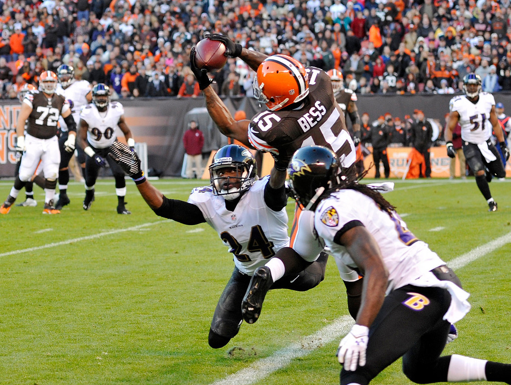 . Cleveland Browns wide receiver Davone Bess (15) makes a 1-yard touchdown catch against Baltimore Ravens cornerback Corey Graham (24) and cornerback Lardarius Webb in the first quarter of an NFL football game Sunday, Nov. 3, 2013. (AP Photo/David Richard)