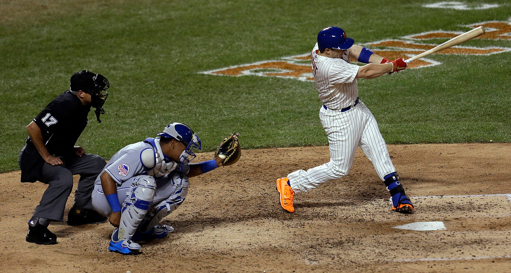 Description of . National Leagueís David Wright, of the New York Mets, hits a single during the seventh inning of the MLB All-Star baseball game, on Tuesday, July 16, 2013, in New York. (AP Photo/Julio Cortez)