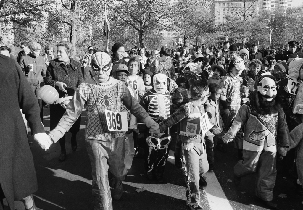 Description of . Youngsters parade through Central Park in New York dressed in their Halloween costumers when the city arranged a party for the kids Oct. 30, 1966. Some 20,000 kids attended the party in the Park. (AP Photo/Jacob Harris)