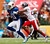 Arizona Cardinals wide receiver Larry Fitzgerald (11) of the NFC attempts to break away from Denver Broncos cornerback Champ Bailey (24) of the AFC after catching a pass in the first quarter of the NFL football Pro Bowl game in Honolulu, Sunday, Jan. 27, 2013. (AP Photo/Eugene Tanner)