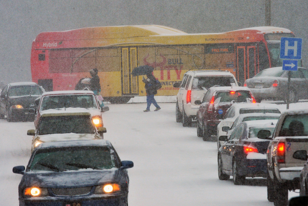Description of . Traffic is snarled and stopped along Main Street, near Anderson Street, as motorists and pedestrians attempt to get home during a winter storm Wednesday Feb. 12, 2014, in Durham, N.C. (AP Photo/The News & Observer, Chuck Liddy)
