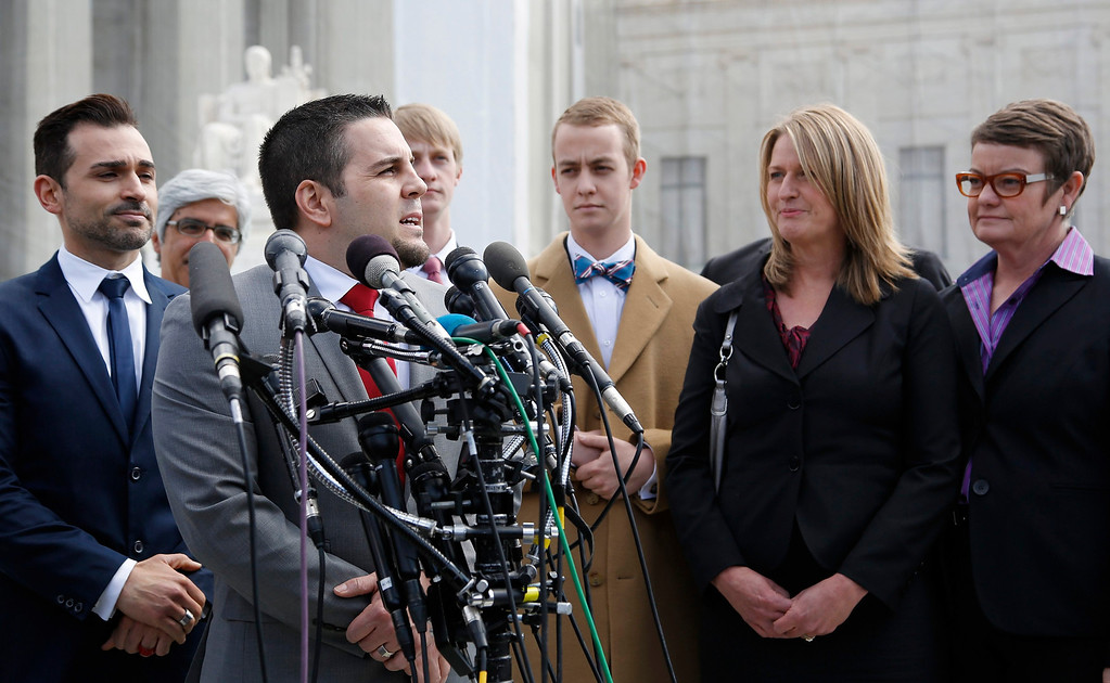 Description of . Plaintiffs Paul Katami (L), Jeff Zarrillo (2nd L), Sandra Stier (2nd R) and Kristin Perry (R) talk to reporters outside the Supreme Court after their case against California\'s Proposition 8 was argued in Washington, March 26, 2013. REUTERS/Jonathan Ernst