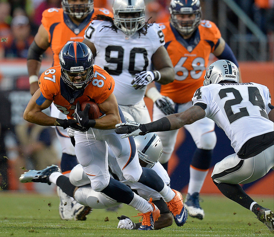 Description of . Denver Broncos wide receiver Eric Decker (87) makes a catch in the first quarter. The Denver Broncos took on the Oakland Raiders at Sports Authority Field at Mile High in Denver on September 23, 2013. (Photo by John Leyba/The Denver Post)