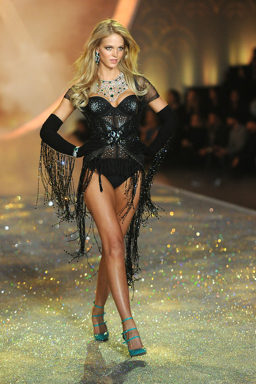 Description of . Model Erin Heatherton walks the runway at the 2013 Victoria's Secret Fashion Show at Lexington Avenue Armory on November 13, 2013 in New York City.  (Photo by Jamie McCarthy/Getty Images)