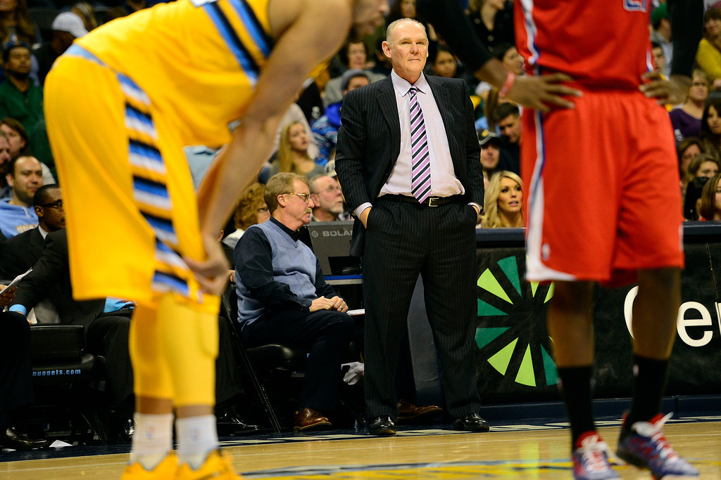 Description of . Denver Nuggets head coach George Karl watches the action against the Los Angeles Clippers during the second half of the Nugget's 92-78 win at the Pepsi Center on Tuesday, January 1, 2013. AAron Ontiveroz, The Denver Post