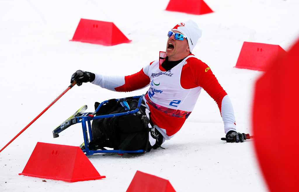 Description of . Sebastien Fortier of Canada crashes during the men's 15-kilometer cross country ski sitting event at the 2014 Winter Paralympics, Sunday, March 9, 2014, in Krasnaya Polyana, Russia. (AP Photo/Dmitry Lovetsky)
