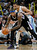 Sacramento Kings center DeMarcus Cousins, front, looks to pass as Denver Nuggets center JaVale McGee defends in the third quarter of the Nuggets' 121-93 victory in an NBA basketball game in Denver on Saturday, Jan. 26, 2013. (AP Photo/David Zalubowski)