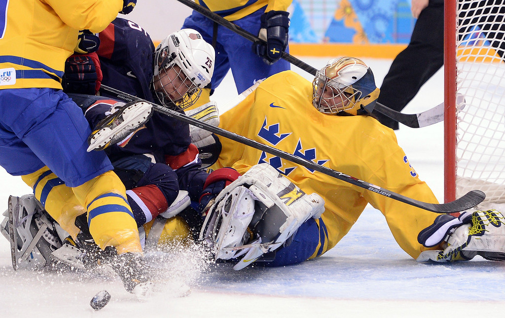 Description of . US Alex Carpenter (L) vies with Sweden's goalkeeper Valentina Lizana Wallner during the Women's Ice Hockey Semifinals USA vs Sweden at the Shayba Arena during the Sochi Winter Olympics on February 17, 2014.     ANDREJ ISAKOVIC/AFP/Getty Images