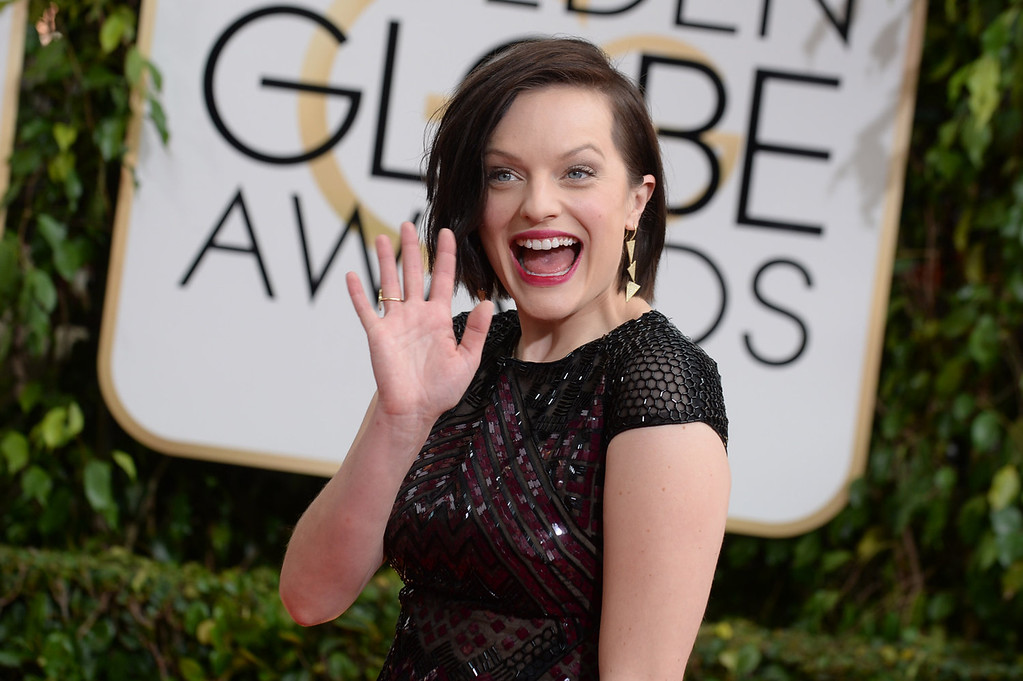 Description of . Elisabeth Moss arrives at the 71st annual Golden Globe Awards at the Beverly Hilton Hotel on Sunday, Jan. 12, 2014, in Beverly Hills, Calif. (Photo by Jordan Strauss/Invision/AP)