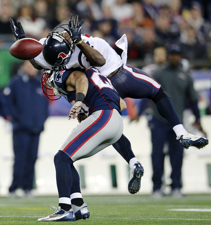 Description of . New England Patriots strong safety Steve Gregory (28) breaks up a pass intended for Houston Texans wide receiver Lestar Jean, top, during the second quarter of an NFL football game in Foxborough, Mass., Monday, Dec. 10, 2012. (AP Photo/Steven Senne)