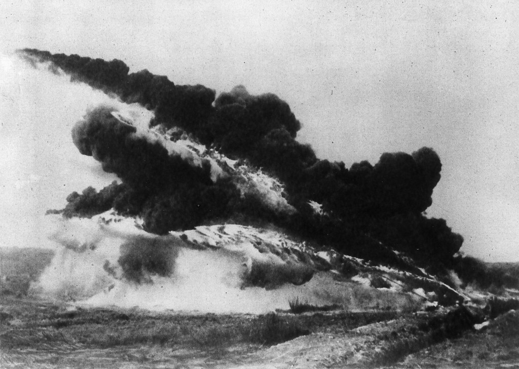 Description of . 30th June 1917:  A flame thrower from WW I spits flame and black smoke into the air.  (Photo by Hulton Archive/Getty Images)