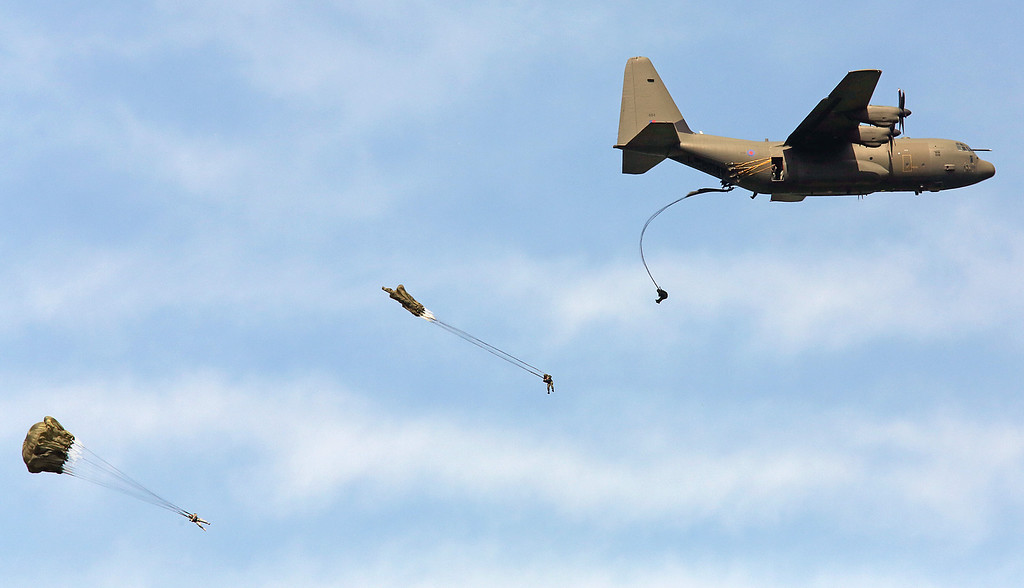 Description of . Paratroopers jump from a French Air Force plane, near Ranville western France, Thursday, June 5, 2014, as part of the commemoration of the 70th anniversary of D Day.  (AP Photo/Remy de la Mauviniere)