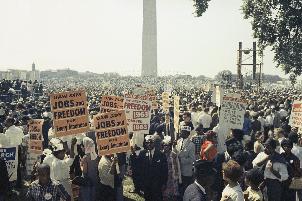 Description of . Large crowds gather near the Washington Monument to demonstrate for the civil rights movement in Washington, D.C. on August 28, 1963. (AP Photo)