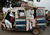 People travel in a motorized rickshaw on a street in the Rae Bareli district of the northern Indian state of Uttar Pradesh January 17, 2012. REUTERS/Adnan Abidi