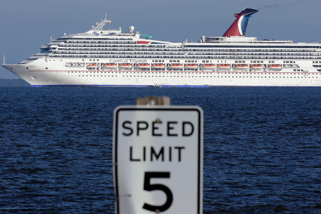 Description of . The cruise ship Carnival Triumph into Mobile Bay near Dauphin island, Ala., Thursday, Feb. 14, 2013.  The ship with more than 4,200 passengers and crew members has been idled for nearly a week in the Gulf of Mexico following an engine room fire. (AP Photo/Dave Martin)