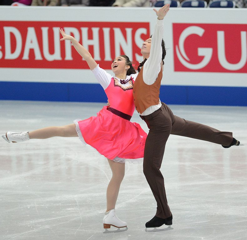 Description of . Cathy Reed and Chris Reed of Japan skate in the Ice Dance Short Dance during day one of the ISU Four Continents Figure Skating Championships at Osaka Municipal Central Gymnasium on February 8, 2013 in Osaka, Japan.  (Photo by Atsushi Tomura/Getty Images)