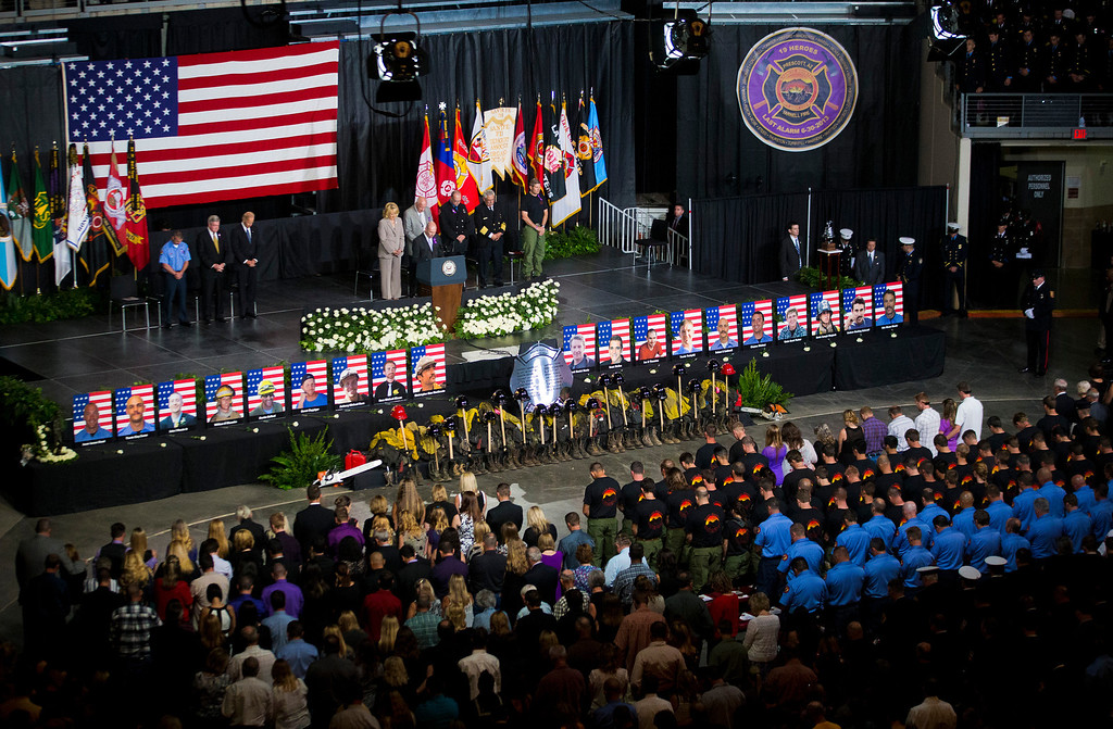 Description of . Pastor Ron Merrell leads a prayer during a memorial service for the 19 fallen firefighters at Tim's Toyota Center in Prescott Valley, Ariz. on Tuesday, July 9, 2013.  (AP Photo/The Arizona Republic, Michael Chow, Pool)