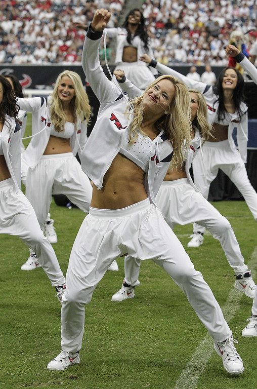 Description of . Houston Texans cheerleaders perform to the music  Vanilla Ice at the halftime between the Tennessee Titans and Houston Texans at Reliant Stadium on September 15, 2013 in Houston, Texas.  (Photo by Bob Levey/Getty Images)