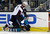 Colorado Avalanche center John Mitchell (7) collides against the boards with San Jose Sharks left wing T.J. Galiardi (21) during the third period of an NHL hockey game in San Jose, Calif., Saturday, Jan. 26, 2013. San Jose won- 4-0.  (AP Photo/Marcio Jose Sanchez)