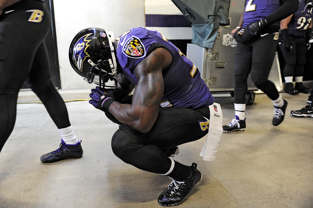 Description of . Strong safety James Ihedigbo #32 of the Baltimore Ravens has a moment to himself before playing the New York Jets at M&T Bank Stadium on November 24, 2013 in Baltimore, Maryland. The Baltimore Ravens won, 19-3.(Photo by Patrick Smith/Getty Images)