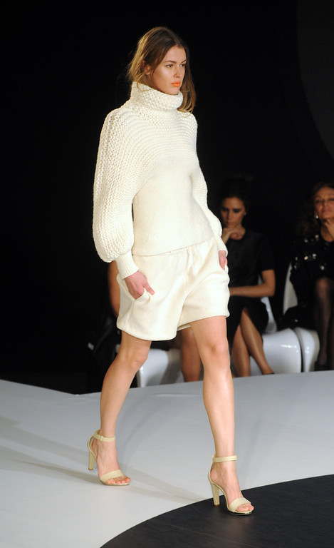 Description of . LONDON, UNITED KINGDOM - FEBRUARY 16: A model walks the runway during the International Woolmark prize grand final during London Fashion Week Fall/Winter 2013/14 at ME Hotel on February 16, 2013 in London, England. (Photo by Stuart Wilson/Getty Images)