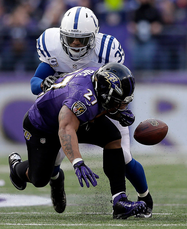 Description of . Baltimore Ravens running back Ray Rice (27) fumbles as he is hit by Indianapolis Colts strong safety Joe Lefeged (35) during the second half of an NFL wild card playoff football game Sunday, Jan. 6, 2013, in Baltimore. (AP Photo/Patrick Semansky)