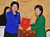 South Korea's incoming president Park Geun-hye, right, and Chinese State Councilor Liu Yandong pose as Park receives letters of Chinese President Hu Jintao and Chinese Communist Party General Secretary Xi Jinping from Liu at the presidential Blue House in Seoul, South Korea, Monday, Feb. 25, 2013. Liu visited Seoul to take part in Park's inauguration ceremony as the 18th South Korean president held earlier in the day. (AP Photo/Kim Jae-hwan, Pool)