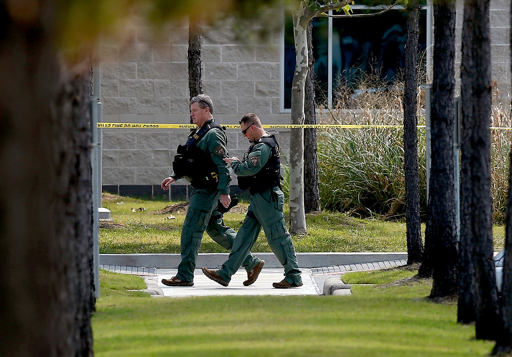 Description of . Harris County Sheriff officers seal off the campus after at least 14 people were injured in a stabbing incident at the Cy-Fair campus of Lone Star College on April 9, 2013 in Cypress, Texas. (Photo by Scott Halleran/Getty Images)