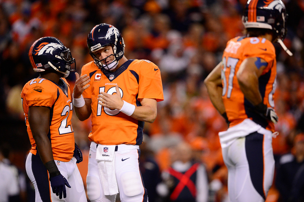 Description of . Denver Broncos quarterback Peyton Manning (18) talks with Denver Broncos running back Knowshon Moreno (27) in the first quarter. The Denver Broncos took on the Oakland Raiders at Sports Authority Field at Mile High in Denver on September 23, 2013. (Photo by AAron Ontiveroz/The Denver Post)