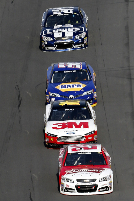 Description of . Kevin Harvick, driver of the #29 Budweiser Chevrolet, leads Greg Biffle, driver of the #16 3M Ford, Martin Truex Jr., driver of the #56 NAPA Auto Parts Toyota, and Jimmie Johnson, driver of the #48 Lowe\'s Chevrolet, during the NASCAR Sprint Cup Series Budweiser Duel 1 at Daytona International Speedway on February 21, 2013 in Daytona Beach, Florida.  (Photo by Sam Greenwood/Getty Images)