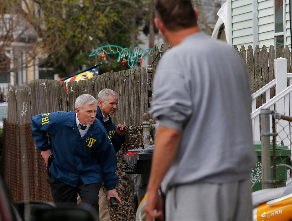 Description of . FBI agents search homes for the Boston Marathon bombing suspects in Watertown, Massachusetts April 19, 2013. REUTERS/Brian Snyder
