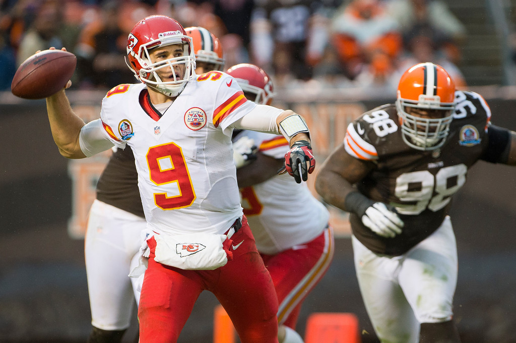 Description of . CLEVELAND, OH - DECEMBER 09: Quarterback Brady Quinn #9 of the Kansas City Chiefs looks for a pass under pressure from defensive tackle Phillip Taylor #98 of the Cleveland Browns during the second half at Cleveland Browns Stadium on December 9, 2012 in Cleveland, Ohio. The Browns defeated the Chiefs 30-7. (Photo by Jason Miller/Getty Images)