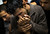 In this Nov. 18, 2012 file photo, a Palestinian man kisses the hand of a dead relative in the morgue of Shifa Hospital in Gaza City. This photo was one in a series of images by Associated Press photographer Bernat Armangue that won the first place prize in the World Press Photo 2013 photo contest for the Spot News series category.  (AP Photo/Bernat Armangue, File)