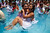 Couples get married inside a public pool during a mass wedding on Valentine's Day in Lima on February 14, 2013. Over 200 couples participated in a community civil marriage organized by the municipality of Comas, northeast of Lima. AFP PHOTO/ERNESTO  BENAVIDES/AFP/Getty Images